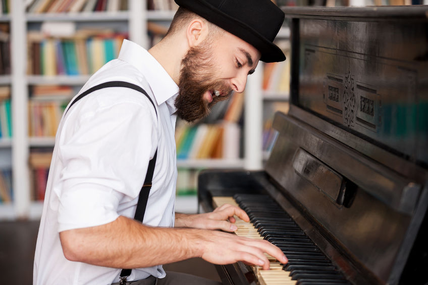 Adult man playing the piano